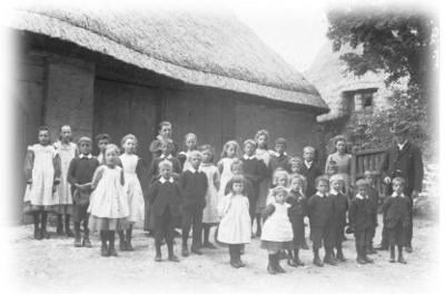 Rev Elkington and school children outside Elsfield school