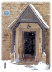 Manor doorway showing plaque to John Buchan