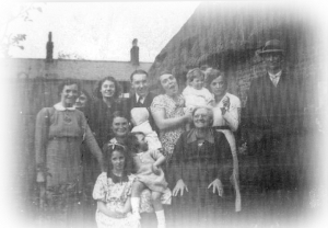The Phipps family outside 2 Terraced Cottages