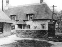 School Cottage with the telephone box to the right